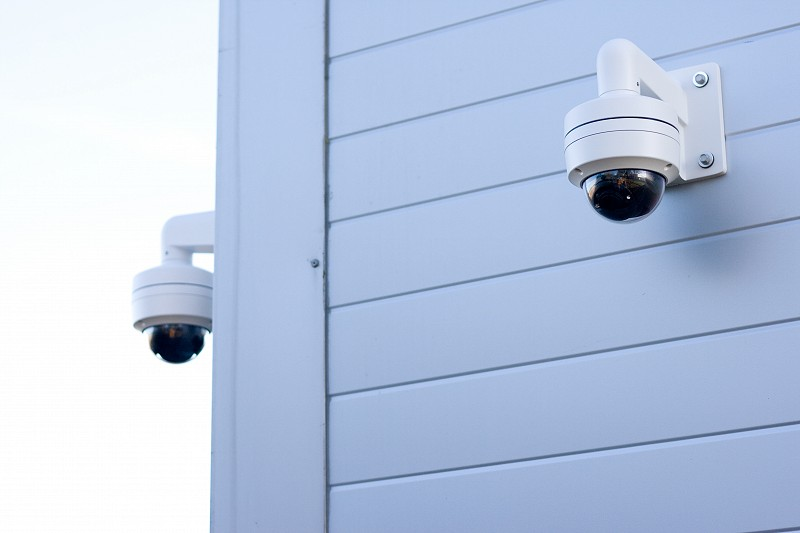 CCTV cameras on aluminium-sided building