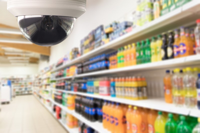 CCTV camera in retail grocery aisle